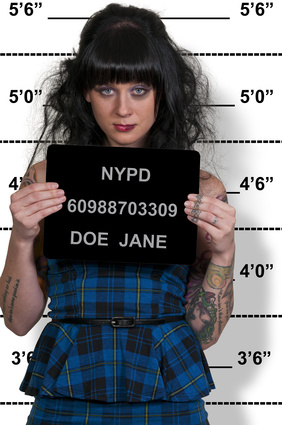 Mugshot of a beautiful young woman criminal