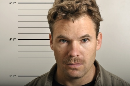 11767038 - police mug shot of scruffy man with mustache